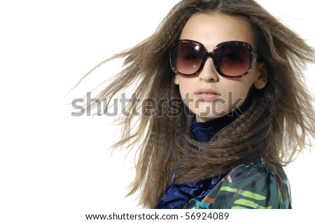 Fashion model wearing modern sunglasses.border