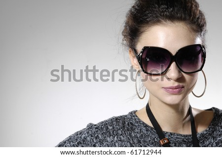 Fashion model wearing modern sunglasses.-isolated - stock photo