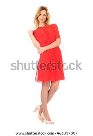 Fashion model wearing red cocktail dress