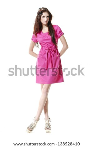 Fashion model wearing red dress with emotions posing - stock photo