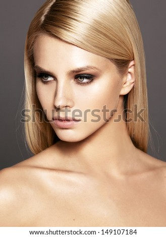 fashion model with bright make-up and straight hair. Smoky eyes  - stock photo