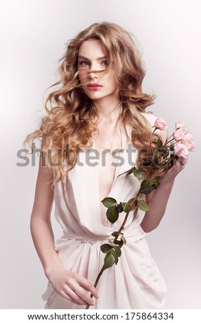Fashion model with flowers , spring look,  - stock photo