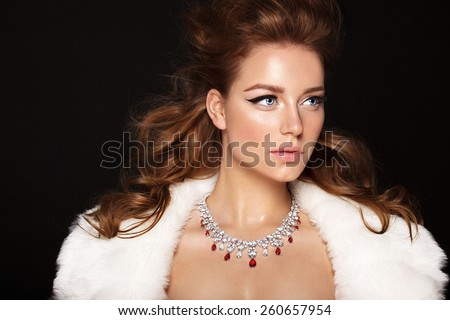 Fashion model with jewelry, modern natural make up. Black background. - stock photo