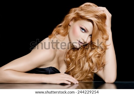 Fashion model with long red hair. - stock photo