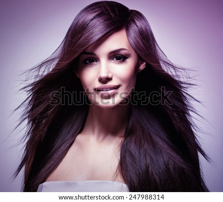 Fashion model with long straight hair. Fashion model posing at studio. Concept image is in tinting colorize style - stock photo
