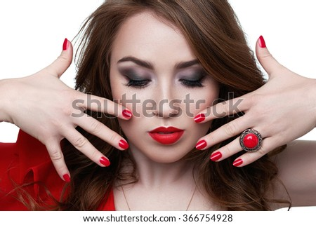 Fashion model with red lipstick and nails. Beauty female face. Perfect skin make up. Red lips  nail polish - stock photo