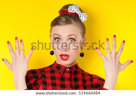 Fashion model with red lipstick and red nails. Portrait of glamour girl with bright makeup. Red lips and nail polish, Beauty female face. Perfect skin and make up.