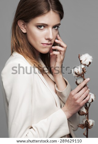 fashion model woman with cotton plant balls in her hands . - stock photo