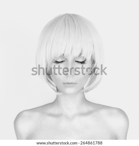fashion monochrome portrait of beautiful blond sexy girl in underwear.stylish young woman with bob haircut - stock photo
