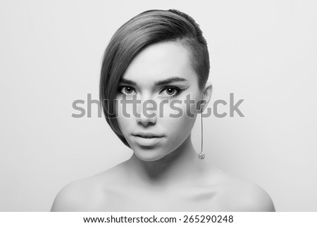fashion monochrome portrait of beautiful young woman with short haircut.pretty girl - stock photo