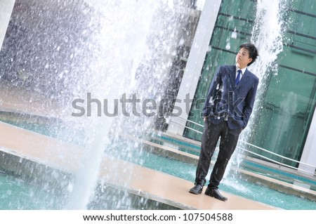 Fashion of graduate in thailand ,graduation boy holding his master's degree.And business action. - stock photo