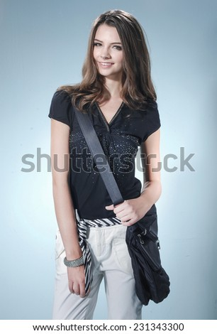fashion or casual girl posing on light background/ Studio shot - stock photo