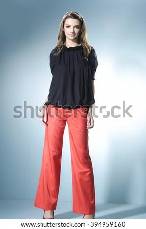 fashion or casual girl posing on light background/ Studio shot - stock photo