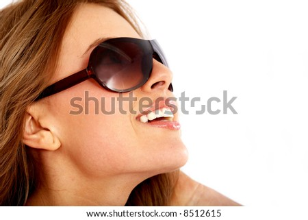 fashion or casual woman portrait wearing sunglasses giving a big smile - isolated over a white background