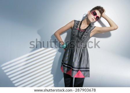 fashion or casual woman portrait wearing sunglasses posing - stock photo