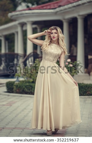 fashion outdoor photo of elegant beautiful woman with blond hair in luxurious sequins dress ,posing in summer park