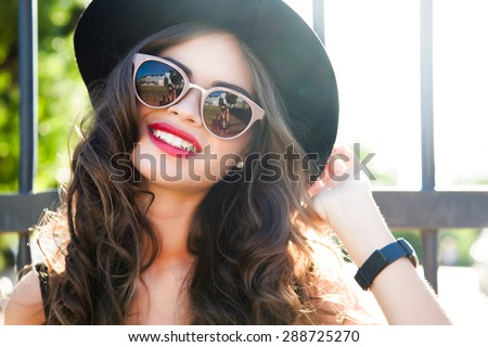 Fashion outdoor portrait of  summer hipster woman wear summer outfit and having fun on the street - stock photo