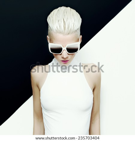 Fashion photo. Blond model with trendy hairstyle. - stock photo