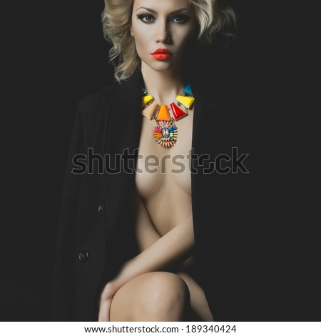 Fashion photo of a beautiful blonde with bright makeup and jewelry - stock photo