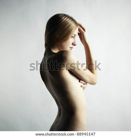 Fashion photo of a beautiful nude woman - stock photo