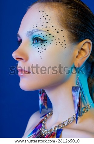 Fashion photo of a young woman . Close-up portrait - stock photo