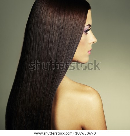 Fashion photo of a young woman with dark hair. Close-up portrait - stock photo