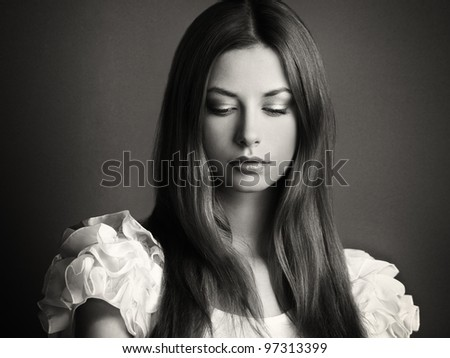 Fashion photo of a young woman with dark hair. The Black-and-white photo - stock photo