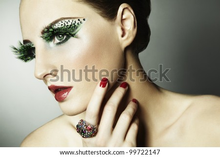 Fashion photo of a young woman with long eyelashes. Close-up portrait