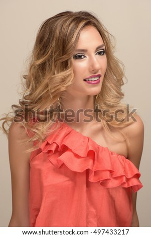 Fashion photo of attractive young blonde woman with styled hair
