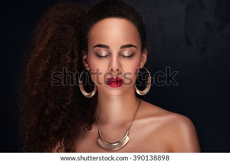Fashion photo of beautiful elegant african american woman. Girl posing in jewelry, wearing fashionable earrings and necklace. Beauty portrait. Studio shot. - stock photo