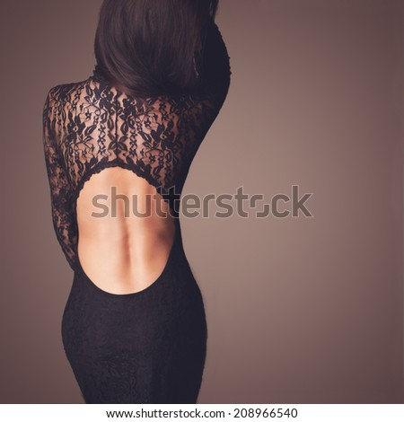 Fashion photo of beautiful lady dressed in evening black lace dress - stock photo