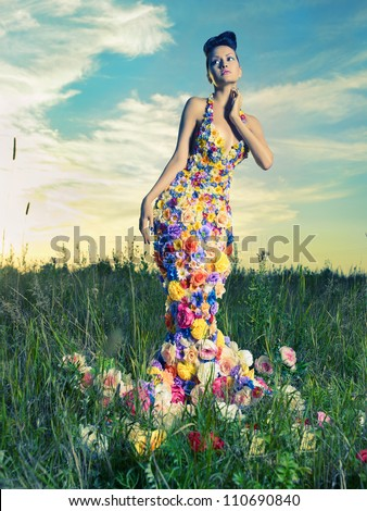 Fashion photo of beautiful lady in dress of flowers - stock photo
