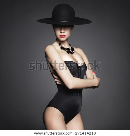 Fashion photo of beautiful lady in elegant black hat - stock photo
