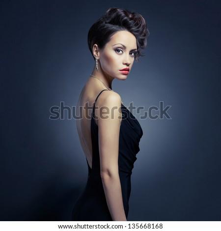 Fashion photo of beautiful lady in elegant evening dress - stock photo