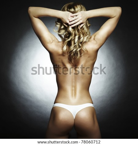 Fashion photo of beautiful nude woman with magnificent hair - stock photo