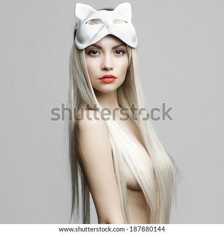 Fashion photo of beautiful sexy blonde in cat mask - stock photo