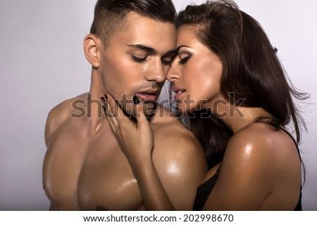 fashion photo of beautiful sexy couple posing at studio - stock photo