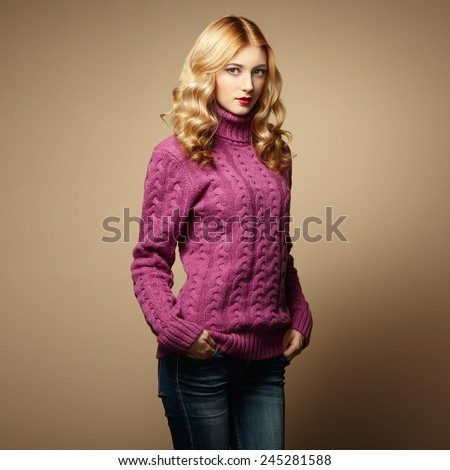 Fashion photo of beautiful woman in sweater. Curly hairstyle. Make-up. Autumn portrait - stock photo