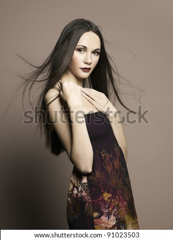 Fashion photo of beautiful woman with magnificent hair