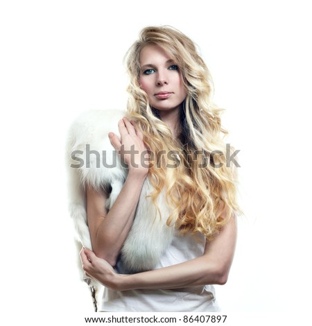 Fashion photo of beautiful woman with magnificent hair in fur - stock photo