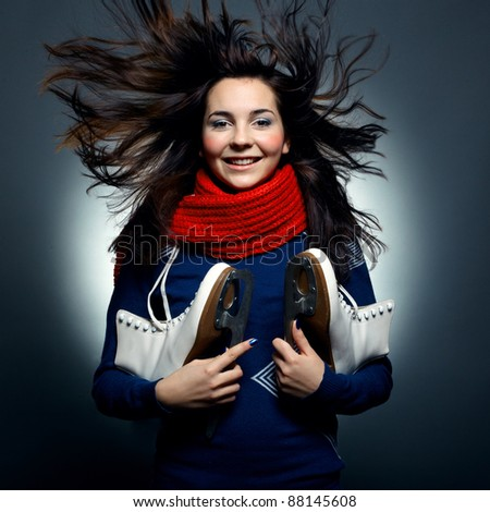 Fashion photo of beautiful woman with magnificent hair. Pretty young smiling girl with the skates
