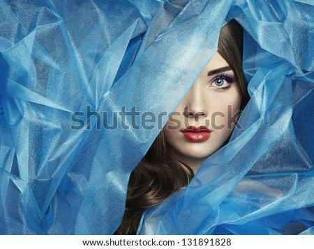 Fashion photo of beautiful women under blue veil. Beauty portrait - stock photo