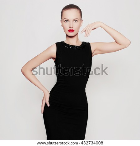 fashion photo of beautiful young woman in a black dress.beauty sexy girl with red lips - stock photo