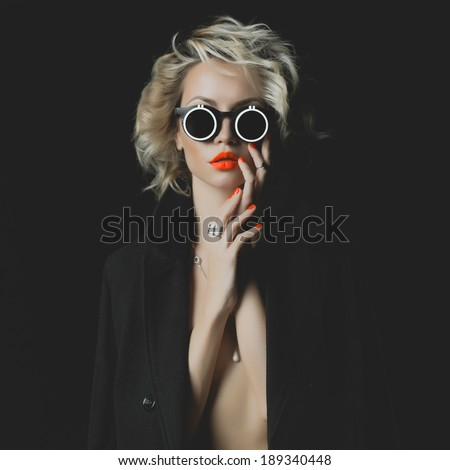 Fashion photo of beauty blonde with bright makeup and accessories - stock photo