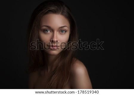Fashion photo of beauty woman on dark background - stock photo
