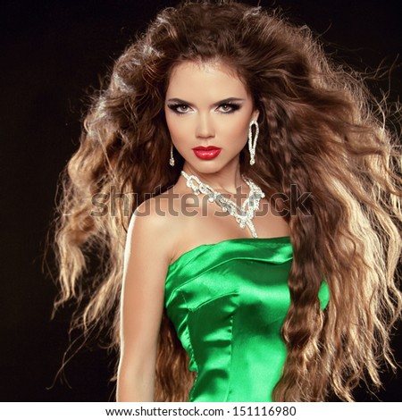 Fashion photo of brunette beauty girl with jewelry isolated on black background - stock photo