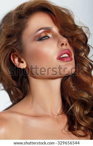 Fashion photo of brunette beauty with stylish make-up. - stock photo