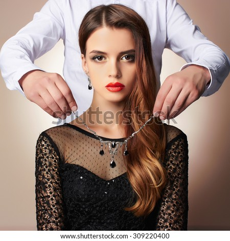 Fashion photo of elegant couple.a man gives a beautiful woman expensive jewelry - stock photo