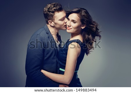 Fashion photo of elegant couple in the tender passion. Studio portrait  - stock photo