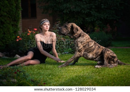 Fashion photo of elegant woman with a big dog - stock photo